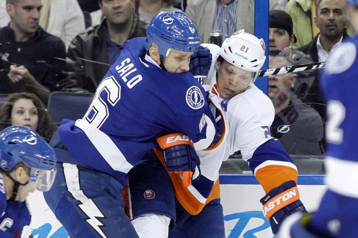 The Lightning's Sami Salo defends against Kyle Okposo of the Islanders Thursday night at the Tampa Bay Times Forum