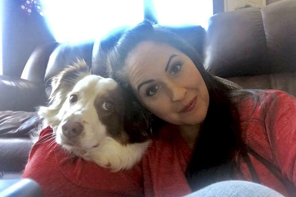 Lindsy Bray is shown with her Australian Shepherd named Dexter. A deal has been reached that will spare the life of Dexter, ordered put to death after he bit a 12-year-old girl in a case that generated criticism from the Humane Society of Utah.