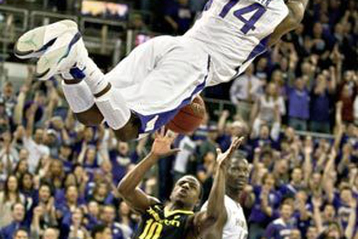 Washington's Tony Wroten throws down a dunk off a steal in the last minute of the Huskies' 90-86 win over Oregon in the NIT Tuesday night. <em>(Seattle Times photo by Dean Rutz)</em>
