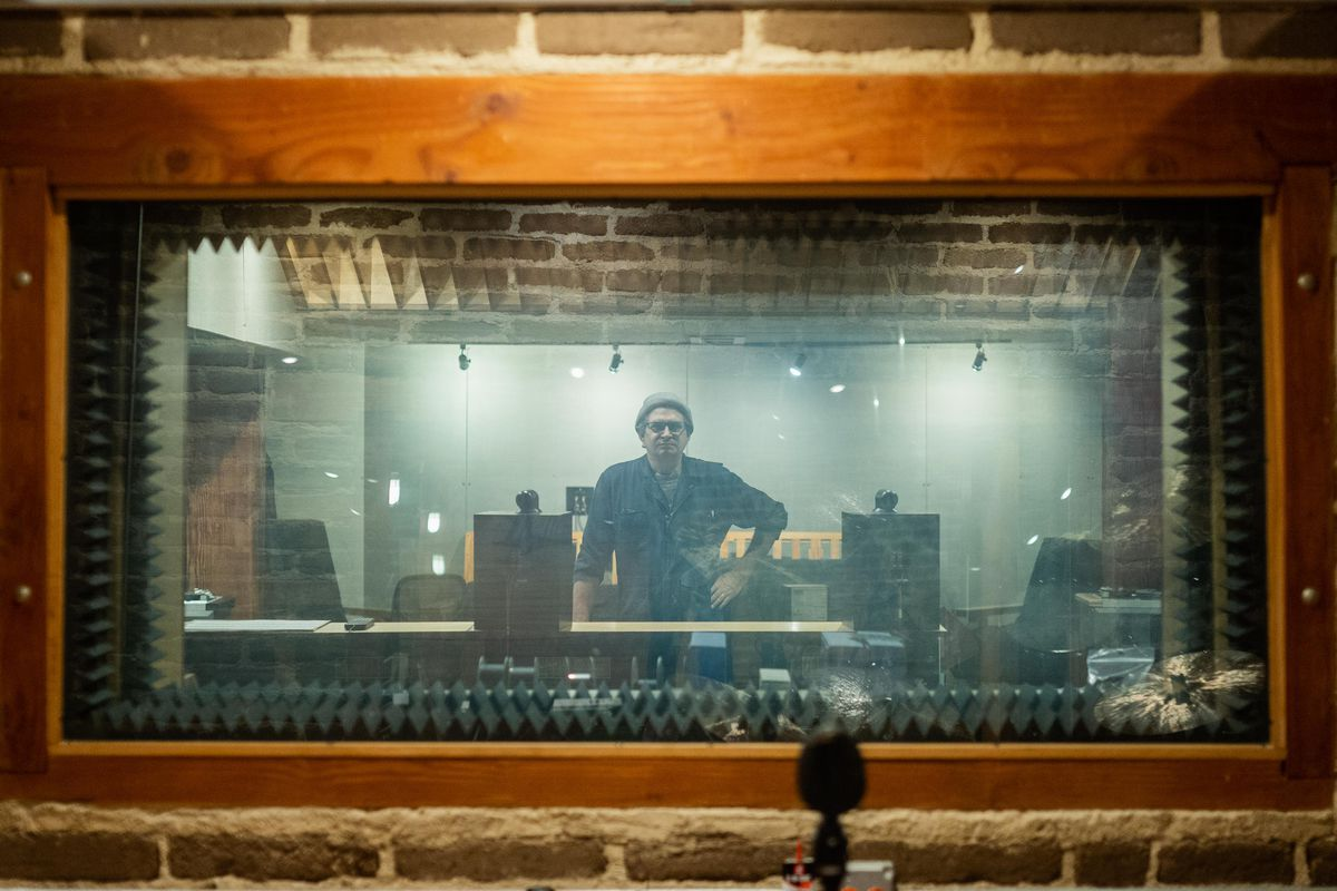 Steve Albini, seen through the recording studio's window at Electrical Audio in August 2021. Albini, prefers to call himself a recording engineer rather than a producer.