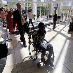 """Abdullahi """"Abdi"""" Mohamed, a Somali refugee, who was shot and critically wounded by police last February, leaves the Matheson Courthouse, Friday, June 23, 2017, in Salt Lake City. Mohamed will be fined $500 after agreeing to a plea deal in what prosecutors call a failed drug deal and assault just before the February 2016 shooting."""