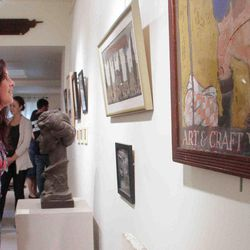 Rachael Carey looks at the art on display at The Arden Craft Shop Museum in Arden, Del. on Sunday, Oct. 14, 2012.  The museum has developed a self-guided walking tour of the community that was launched this month along with its annual exhibit.