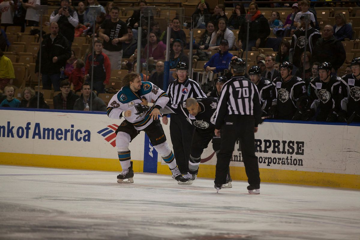 Worcester Sharks defenseman Matt Pelech scraps with Manchester Monarchs enforcer Justin Johnson early in the third period Friday night at the DCU Center.