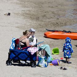 Adults and children enjoy the weather as the Utah Department of Transportation and the Sleep Smart Drive Smart campaign host a media briefing at Blackridge Reservoir in Herriman on Wednesday, June 14, 2017. Spending all day playing in the sun can cause fatigue and drowsy driving.