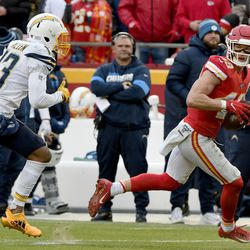 Kansas City Chiefs safety Daniel Sorensen (49) intercepts a pass intended for Los Angeles Chargers wide receiver Keenan Allen, left, during the second half of an NFL football game in Kansas City, Mo., Sunday, Dec. 29, 2019.