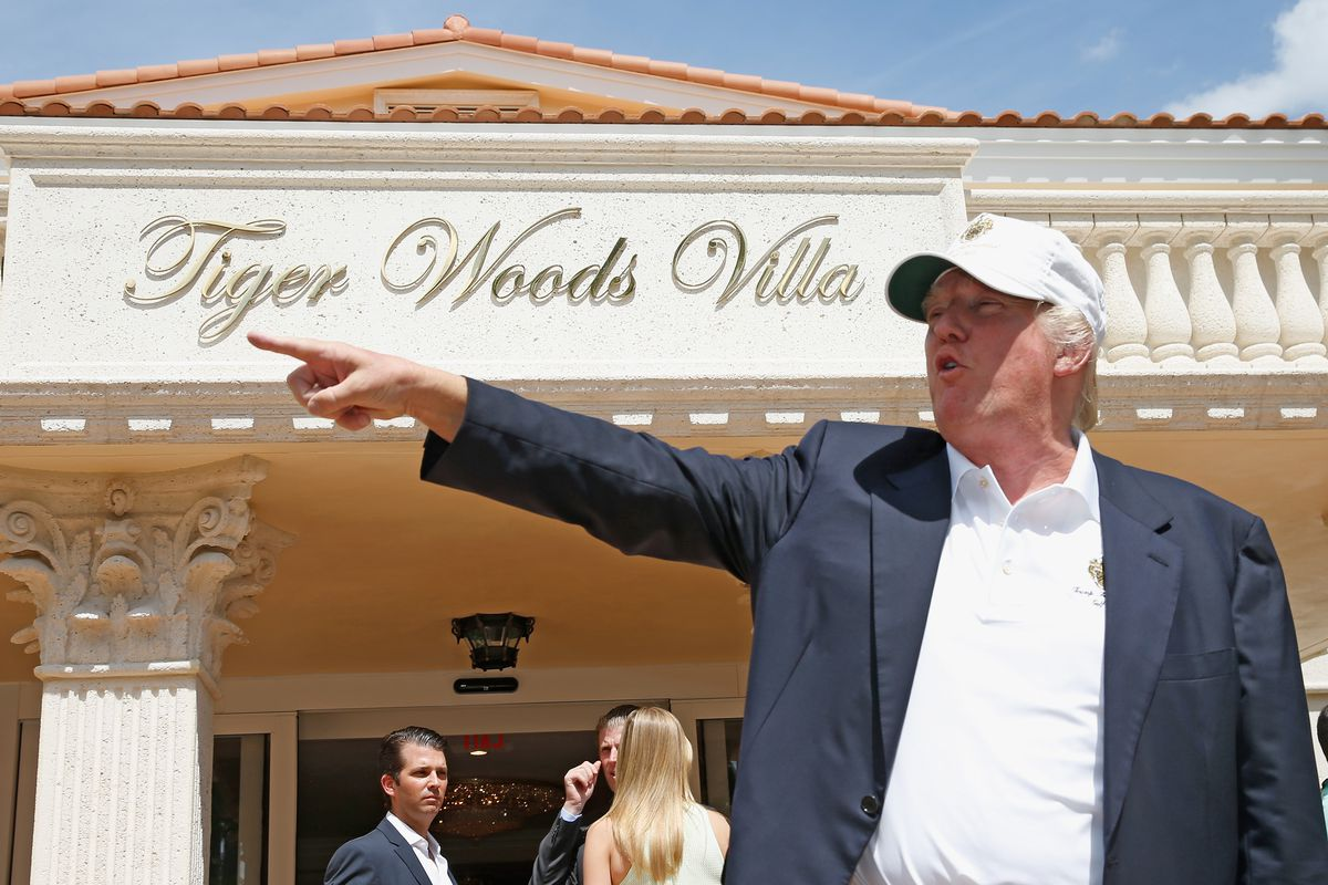 Trump stands outside a villa at his Doral club; his children are behind him.