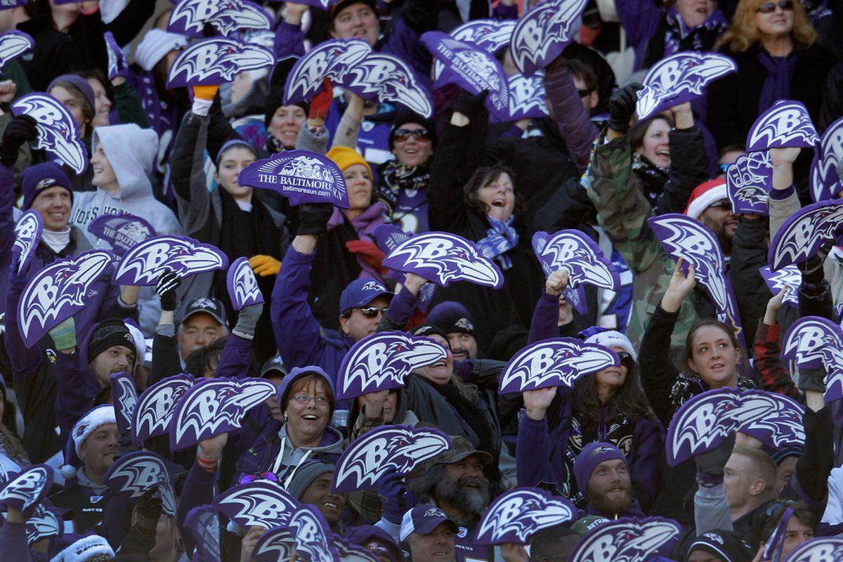 BALTIMORE, MD - DECEMBER 24: Baltimore Ravens fans hold up foam logos during the second half against the Cleveland Browns at M&T Bank Stadium on December 24, 2011 in Baltimore, Maryland.  (Photo by Rob Carr/Getty Images)