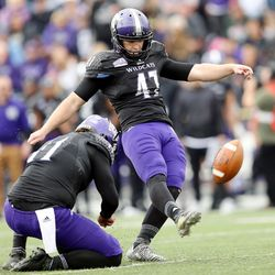 Weber State Wildcats place kicker Trey Tuttle (47) kicks an extra point as Weber State vs. Western Illinois play at Stewart Stadium in Ogden Utah on Saturday, Nov. 25, 2017.