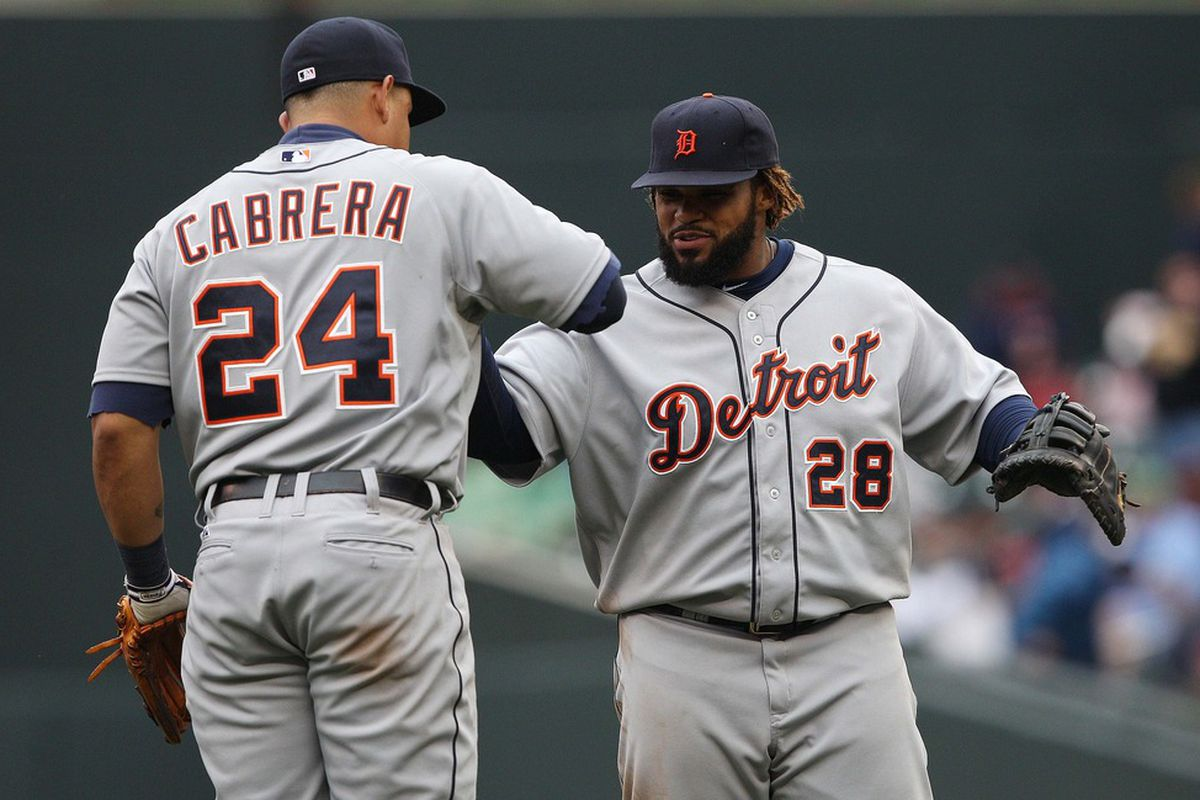 May 26, 2012; Minneapolis, MN, USA: Detroit Tigers first baseman Prince Fielder (28) and third baseman Miguel Cabrera (24) celebrate after beating the Minnesota Twins at Target Field. The Tigers won 6-3. Mandatory Credit: Jesse Johnson-US PRESSWIRE