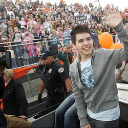 """""""American Idol"""" finalist David Archuleta, a Murray High School student, rides around the school's track during a pep rally Friday."""