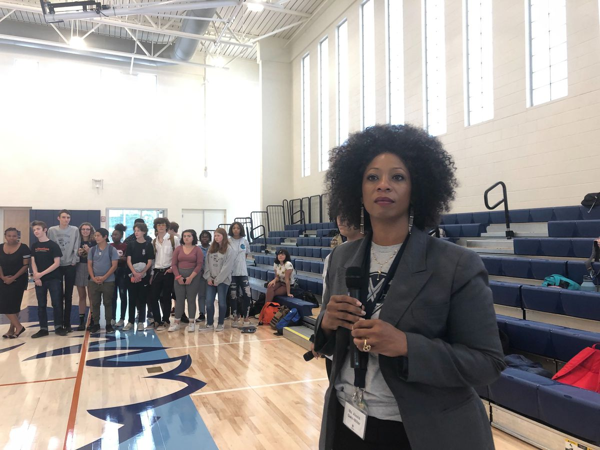 Principal Alexis Gwin-Miller addresses students during a town hall meeting.