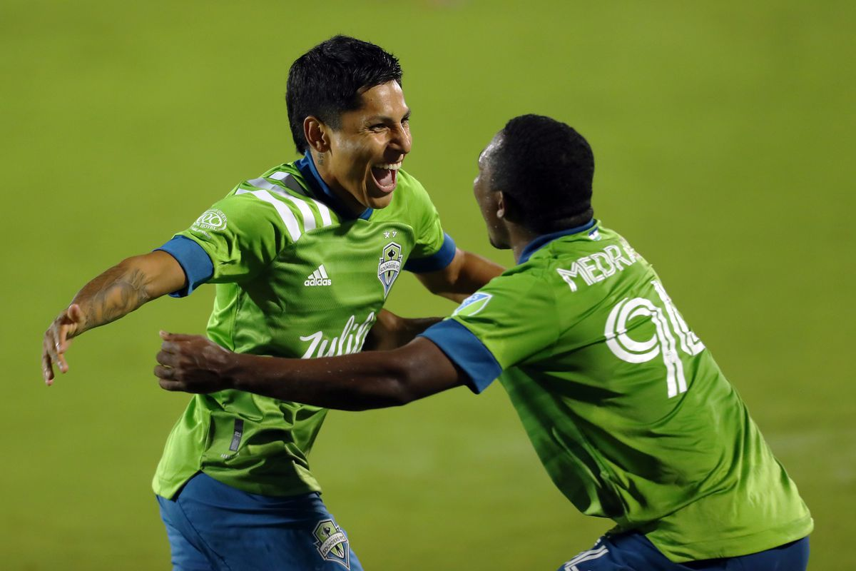 Raúl Ruidíaz #9 of Seattle Sounders FC celebrates with his teammate Jimmy Medranda # 94 after scoring his team's first goal during the MLS game between FC Dallas and Seattle Sounders FC at at Toyota Stadium on August 18, 2021 in Frisco, Texas.