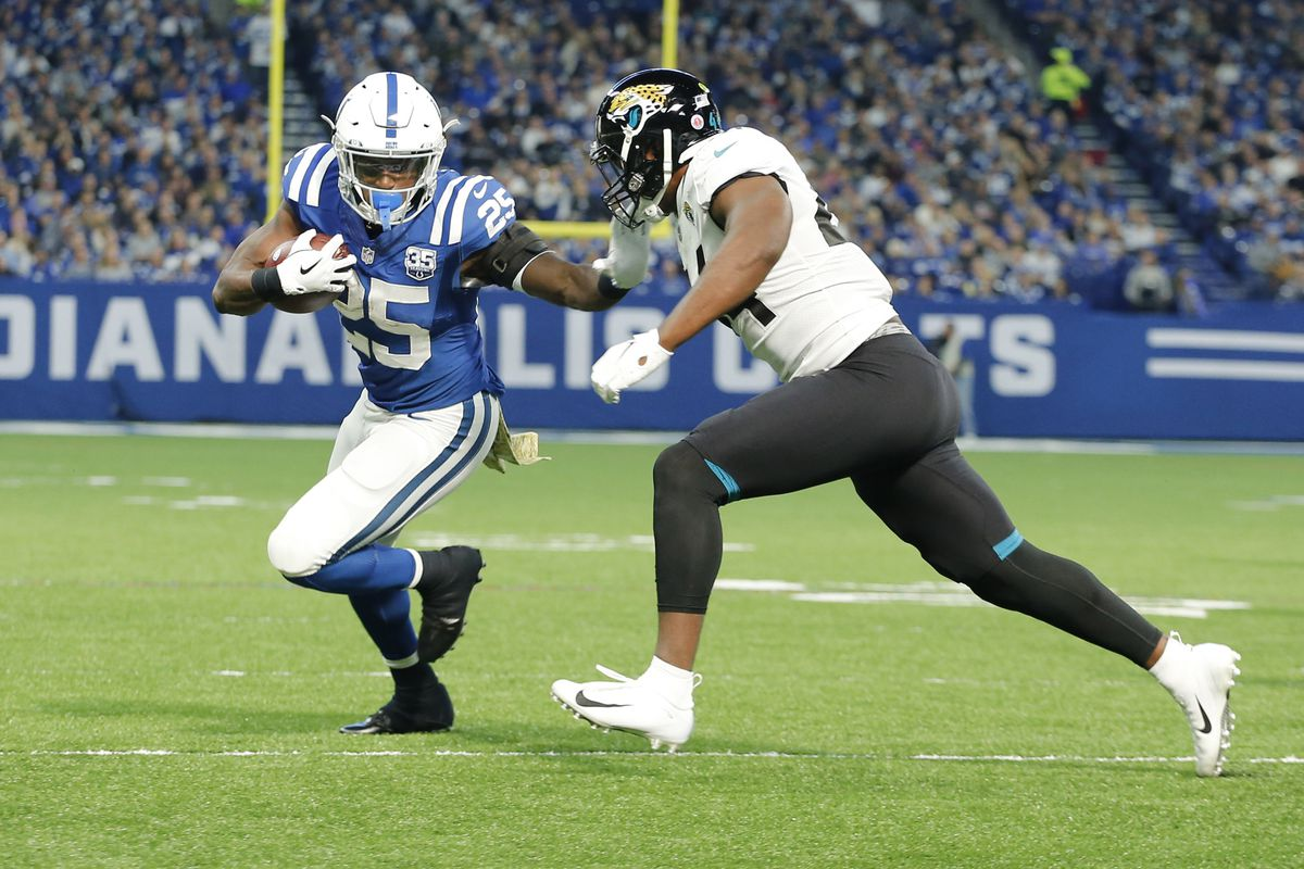 Indianapolis Colts running back Marlon Mack runs the ball against the Jacksonville Jaguars during the first quarter at Lucas Oil Stadium.