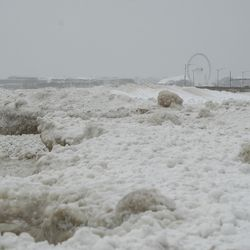 Navy Pier is seen from Oak Street Beach in the Loop, Tuesday morning, Jan. 26, 2021. Three inches of snow enveloped Chicago as the winter storm passed through northern Illinois.