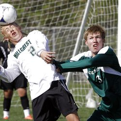 Carter Woolf of Hillcrest, left, and James Webb of Olympus battle for control of the ball as Olympus High School plays Hillcrest High School in boys soccer in MIdvale, Friday, April 27, 2012.