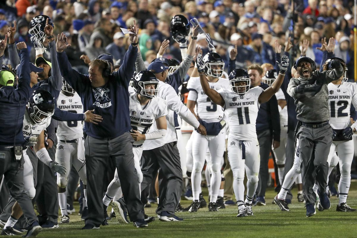 The Utah State Aggies beach celebrates a touchdown during the Utah State versus BYU football game at LaVell Edwards Stadium in Provo on Friday, Oct. 5, 2018.