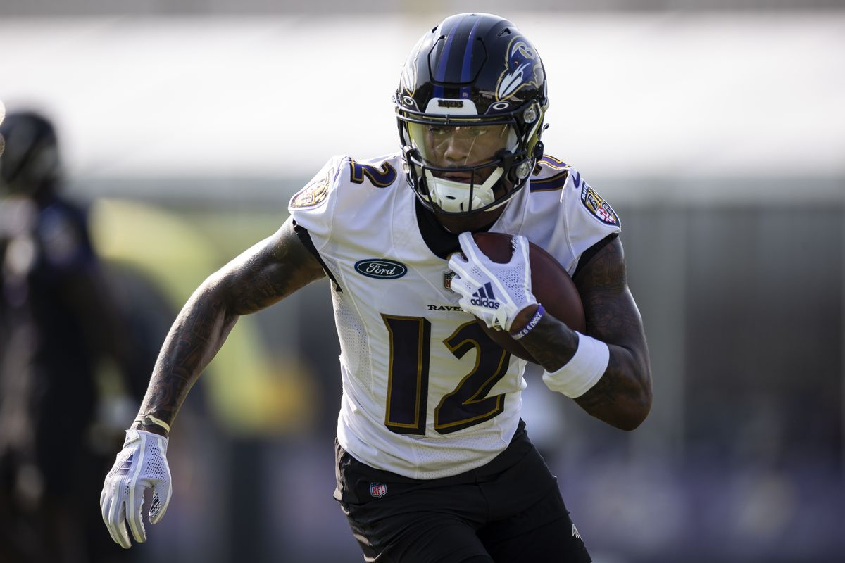 Rashod Bateman #12 of the Baltimore Ravens in action during training camp at Under Armour Performance Center Baltimore Ravens on July 28, 2021 in Owings Mills, Maryland.
