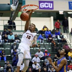 Morgan Park's Isaiah Burrell (10) dunks ahead of Simeon's Andre Casey (23)  in their CPS semi final game at Chicago State University, Friday, February 15, 2019. | Kevin Tanaka/For the Sun Times