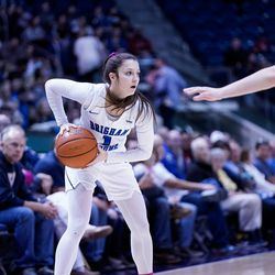 BYU's Brenna Chase Drollinger scans the court for an open player during the Cougars' 65-54 win over Pacific at the Marriott Center in Provo on Saturday, Feb. 15, 2020.