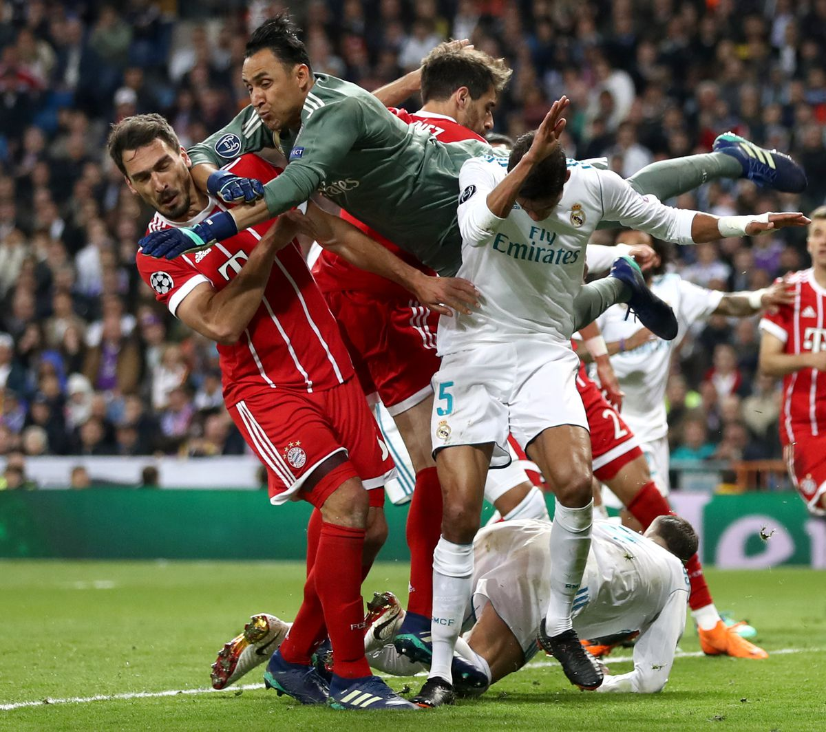 MADRID, SPAIN - MAY 01: Keylor Navas of Real Madrid punches the ball clear under pressure from Mats Hummels of Bayern Muenchen during the UEFA Champions League Semi Final Second Leg match between Real Madrid and Bayern Muenchen at the Bernabeu on May 1, 2018 in Madrid, Spain.