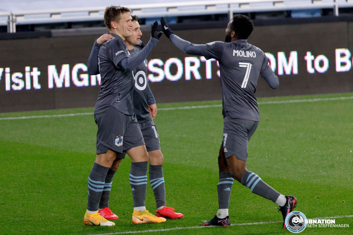 November 22, 2020 - Saint Paul, Minnesota, United States - Minnesota United midfielder Robin Lod (17) celebrates with teammates Ethan Finlay (13) and Kevin Molino (7) after scoring a goal during the first round playoff match against the Colorado Rapids at Allianz Field.