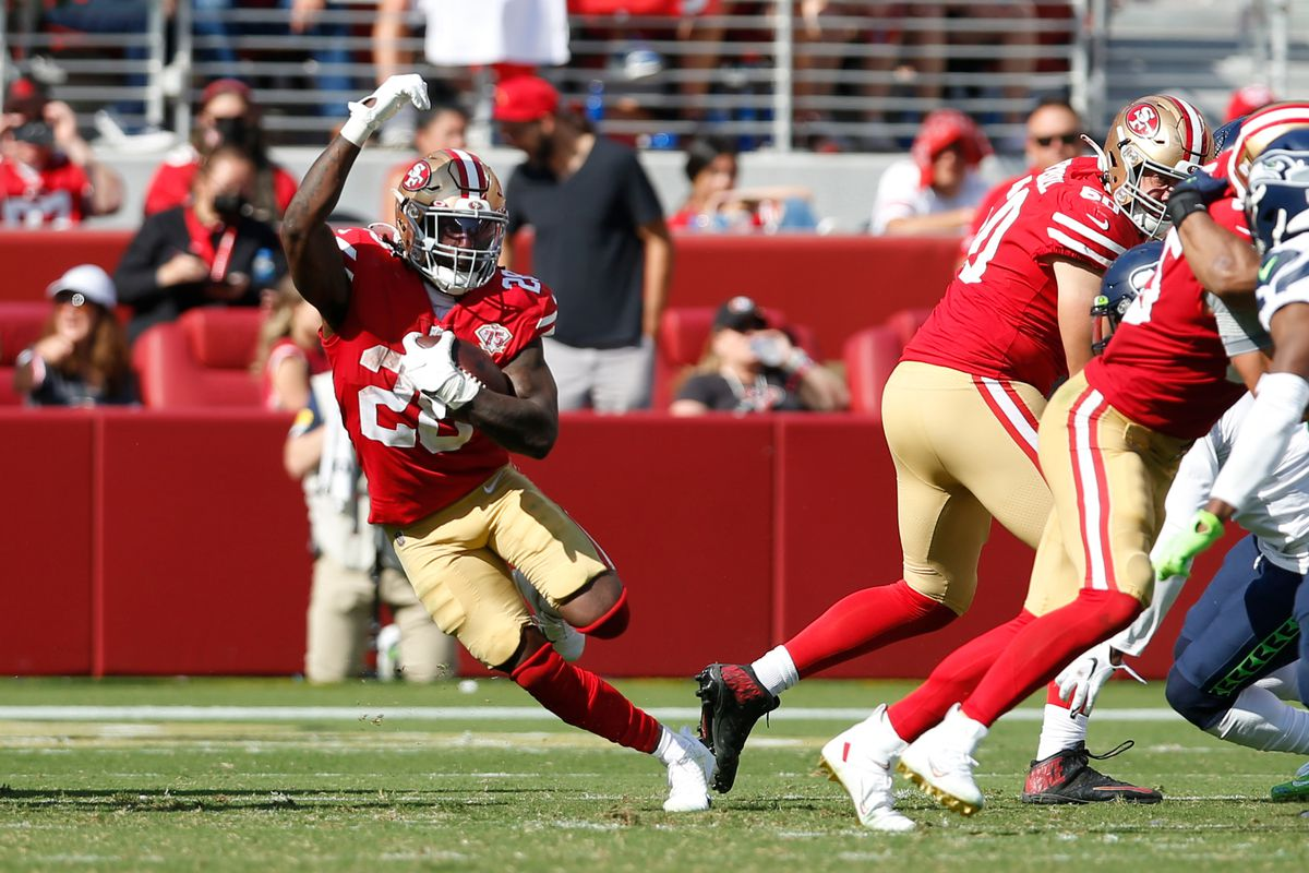 Trey Sermon #28 of the San Francisco 49ers rushes during the game against the Seattle Seahawks at Levi's Stadium on October 3, 2021 in Santa Clara, California.