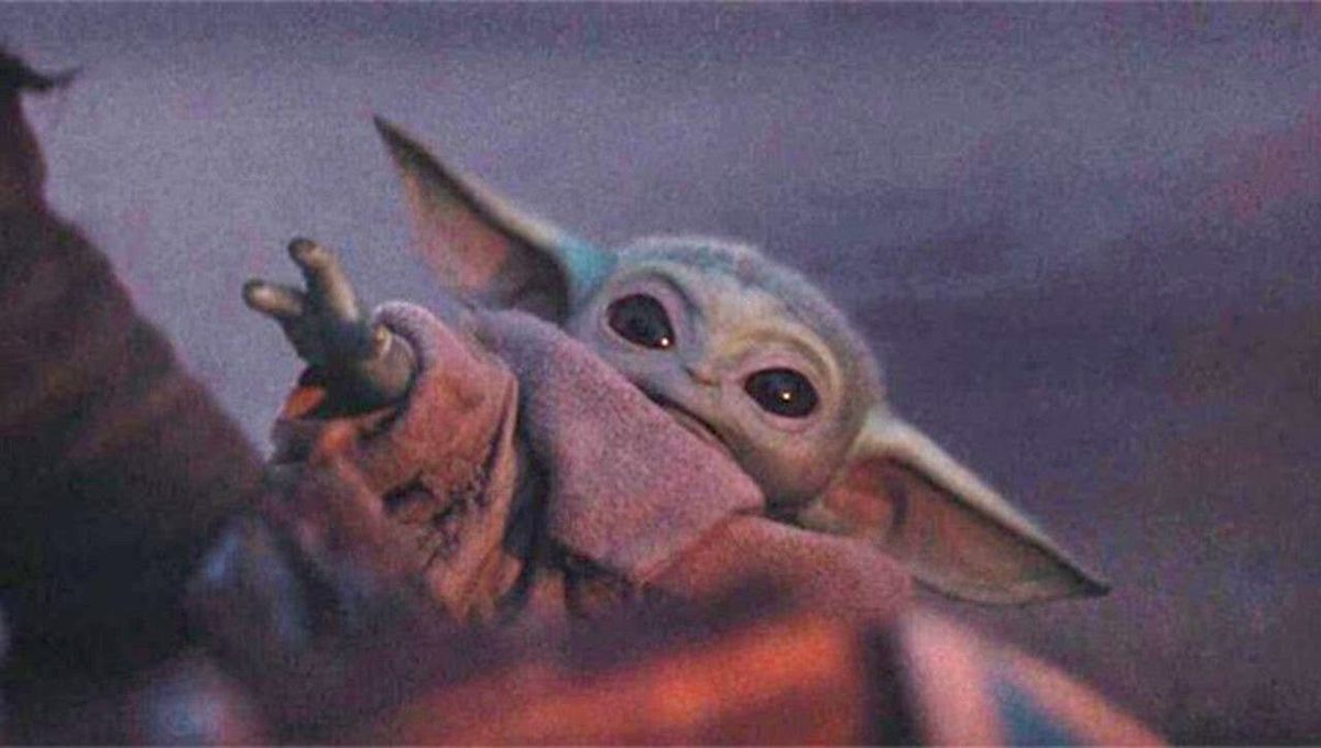 Baby Yoda reaching out with his wee little hand