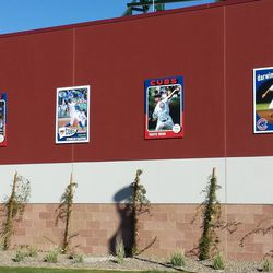 Giant baseball card replicas of Cubs players on an outer wall