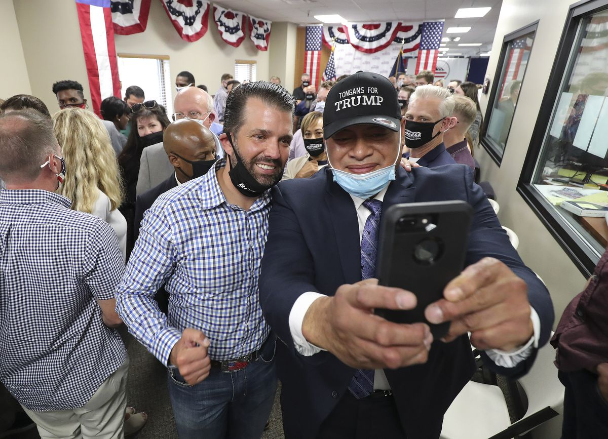 Moses Tauteoli, right, takes a selfie with Donald Trump Jr. at Colonial Flag in Sandy on Thursday, July 23, 2020.