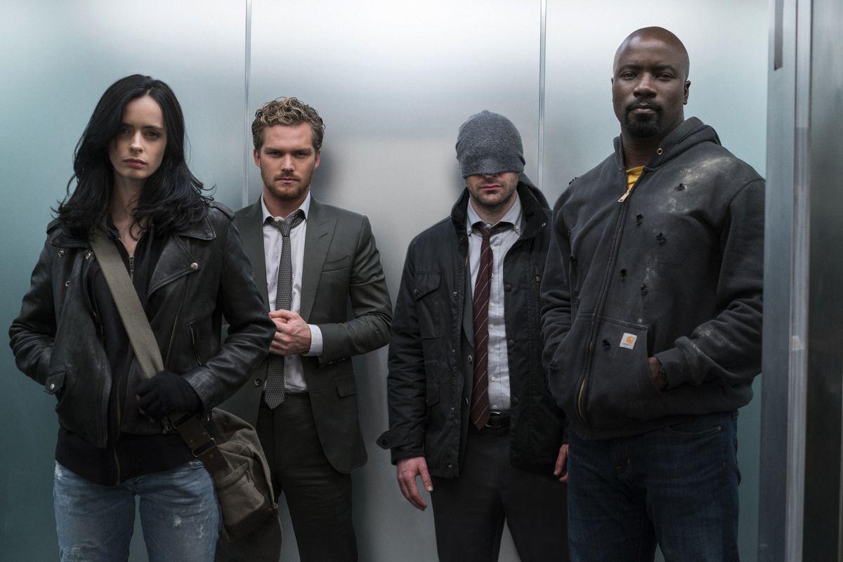 Jessica Jones, Danny Rand, Matt Murdock and Luke Cage in an elevator