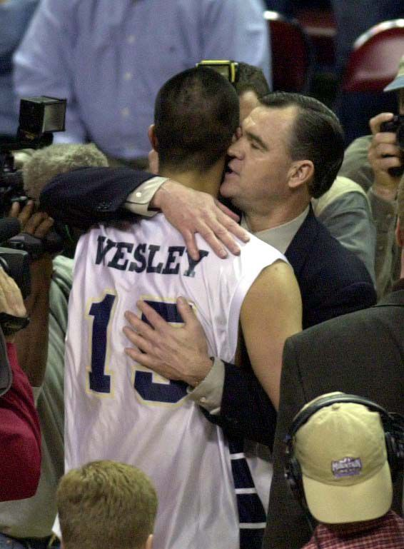 Mekeli Wesley hugs BYU coach Steve Cleveland after BYU defeated New Mexico in the MWC Tournament championship game in Las Vegas, March 10, 2001.