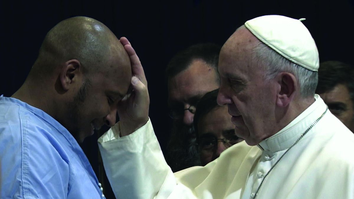 Pope Francis greets an inmate in Philadelphia