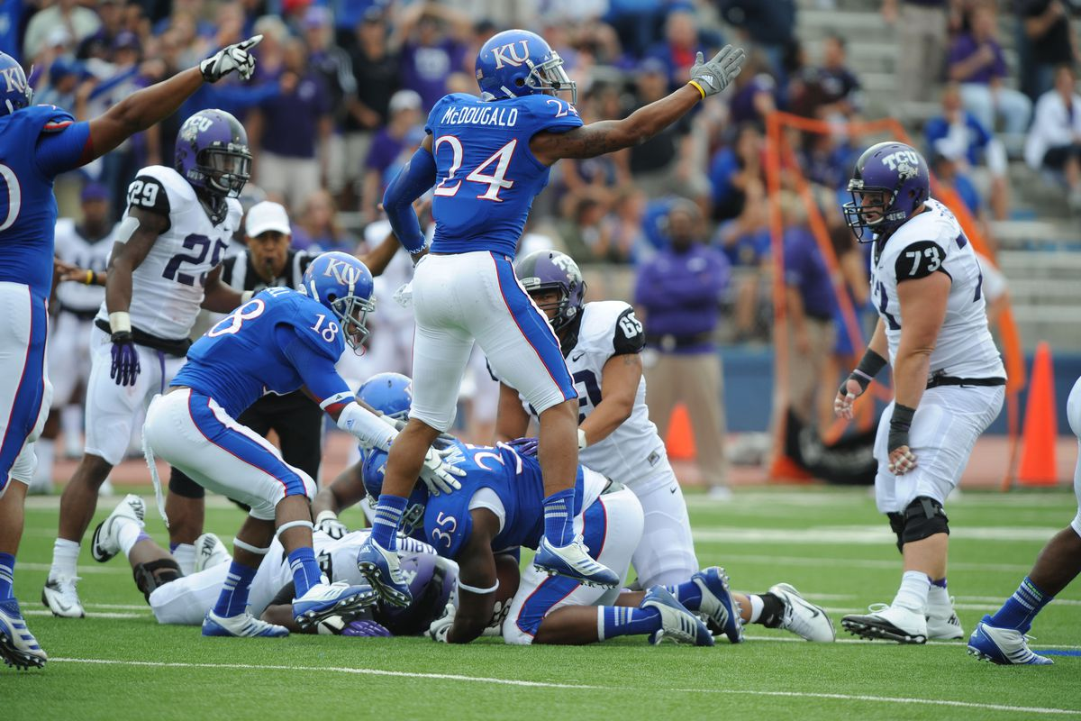 Sep 15, 2012; Lawrence, KS, USA; Kansas Jayhawks safety Bradley McDougald (24) celebrates after causing a fumble against the Texas Christian Horned Frogs in the first half at Memorial Stadium. Mandatory Credit: John Rieger-US PRESSWIRE
