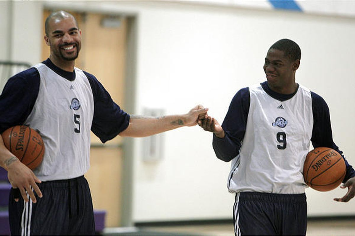 Utah Jazz players Carlos Boozer, left, and Ronnie Brewer share a laugh during practice Tuesday.