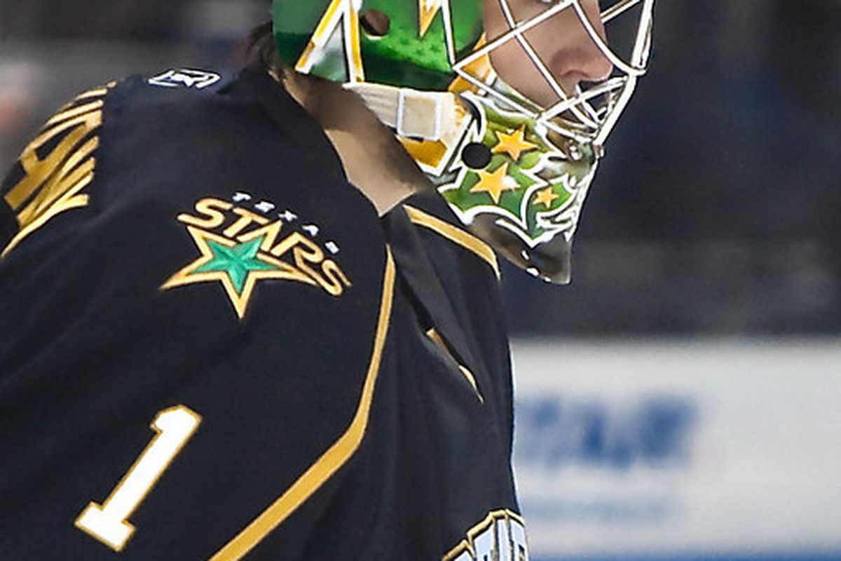 """Rookie goalie Tyler Beskorowany pays tribute to the Stars heritage with a North Stars logo on the right side of his mask. (Credit: <a href=""""http://ahlinphotos.blogspot.com"""" target=""""new"""">Chris Jerina/AHL In Photos</a>)"""