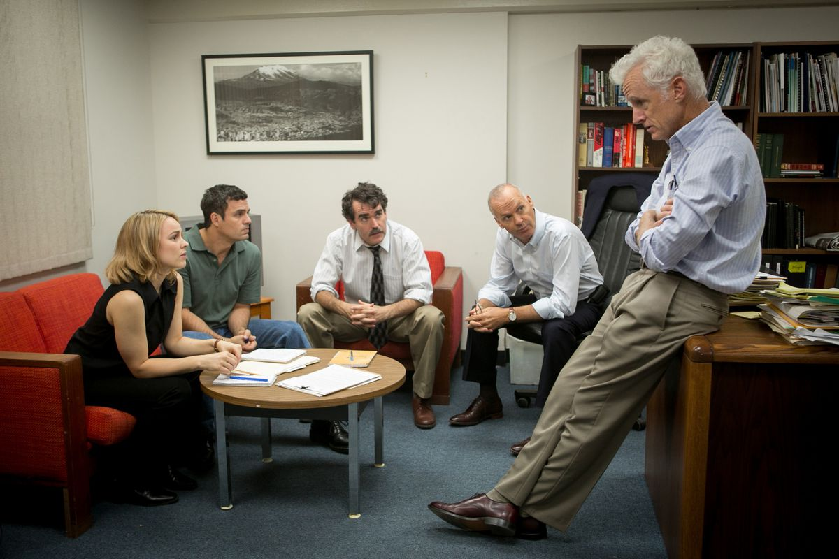 The Spotlight team gathers with their editor to hash out the story.