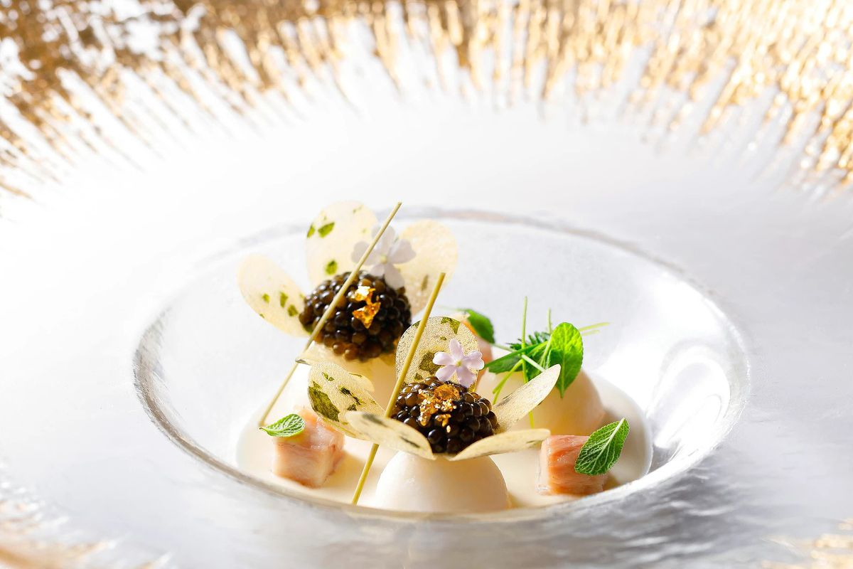 An elegantly plated dish that includes caviar