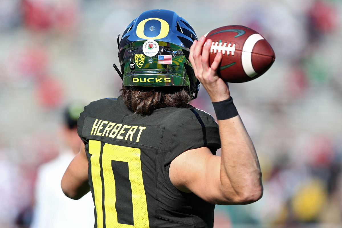 Justin Herbert #10 of the Oregon Ducks warms up prior to Rose Bowl game presented by Northwestern Mutual against the Wisconsin Badgers at Rose Bowl on January 01, 2020 in Pasadena, California.
