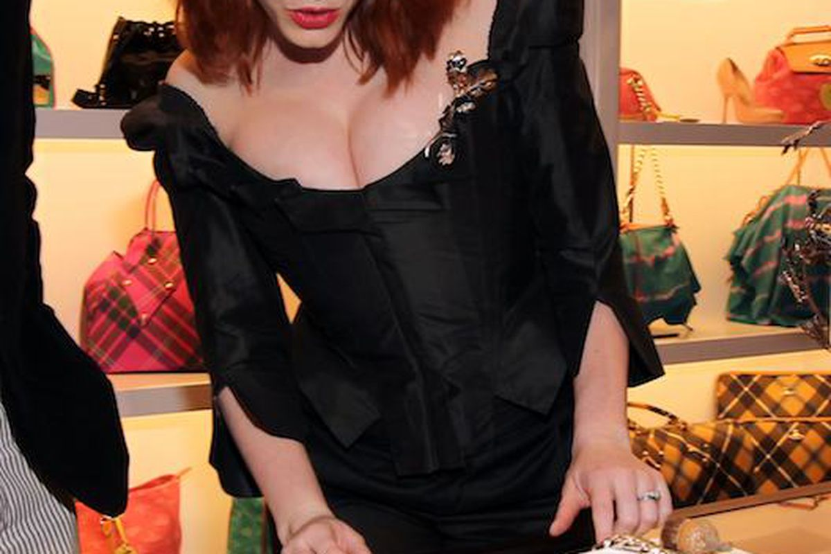 Christina Hendricks checking out the wares, credit: Getty Images