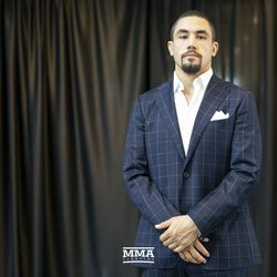 Robert Whittaker poses at UFC 225 media day.