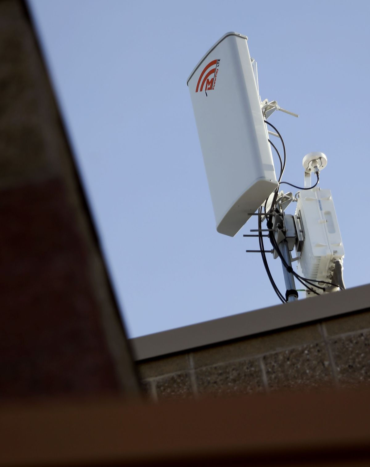 A transmitter that connects a wireless broadband network is visible on the roof of the Murray City School District office on Thursday, Jan.14, 2021. The district is the first in the nation to create and launch its own wireless broadband network for students.