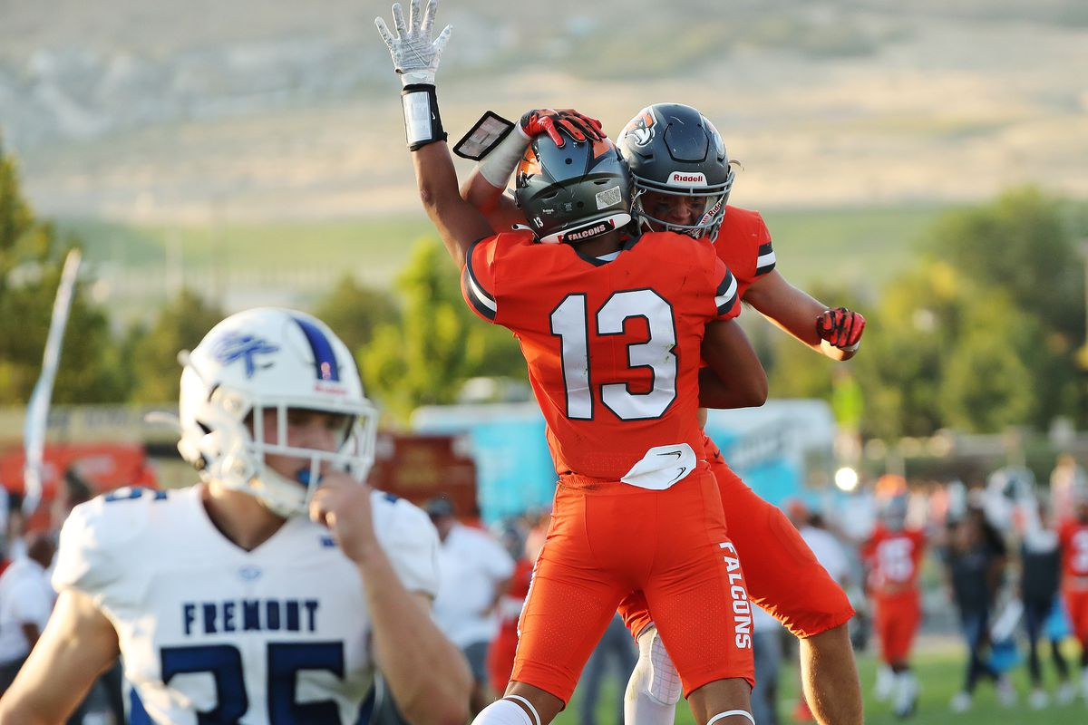 Skyridge's Zeke Greco (13) celebrates catching a long pass with Jack Hadfield against Fremont in Lehi during the 2021 high school football season opener.