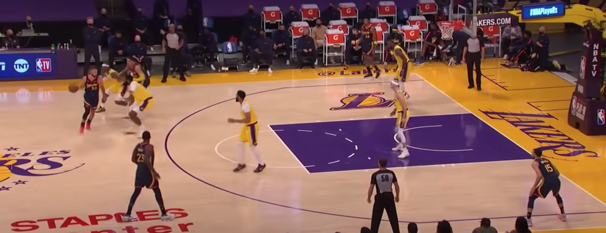 Stephen Curry scores on the Lakers