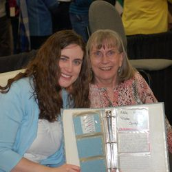 Joella Peterson and her mother, Lucy Peterson, display a family recipe book that Joella created when she was 9. The book has a recipe for each of her ancestors.
