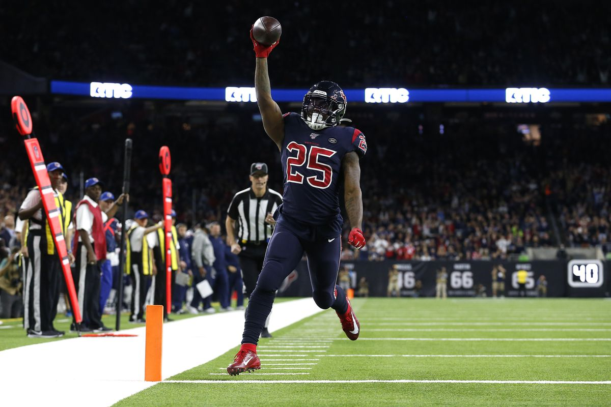 Duke Johnson #25 of the Houston Texans celebrates after scoring a 14 yard touchdown against the New England Patriots during the first quarter in the game at NRG Stadium on December 01, 2019 in Houston, Texas.