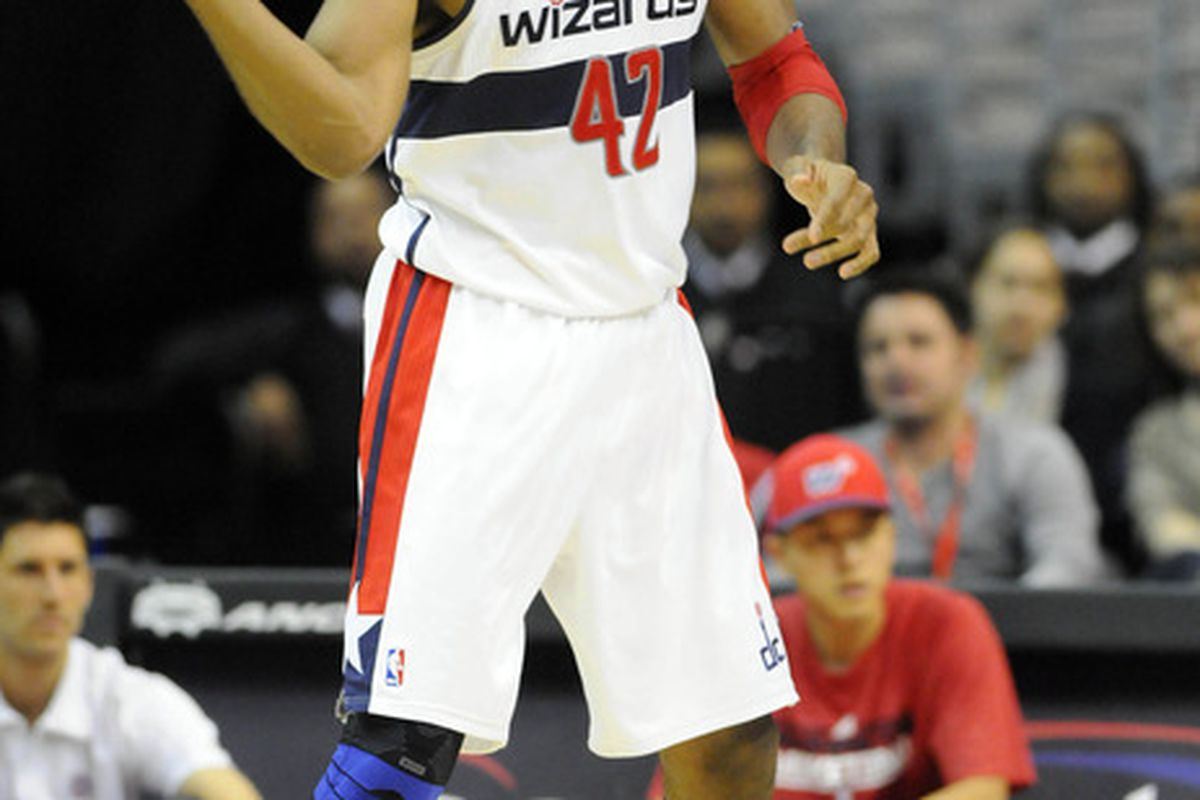 Mar 26, 2012; Washington, DC, USA; Washington Wizards center Nene (42) passes the ball against the Detroit Pistons during the second half at the Verizon Center. The Pistons defeated the Wizards 79 - 77. Mandatory Credit: Brad Mills-US PRESSWIRE