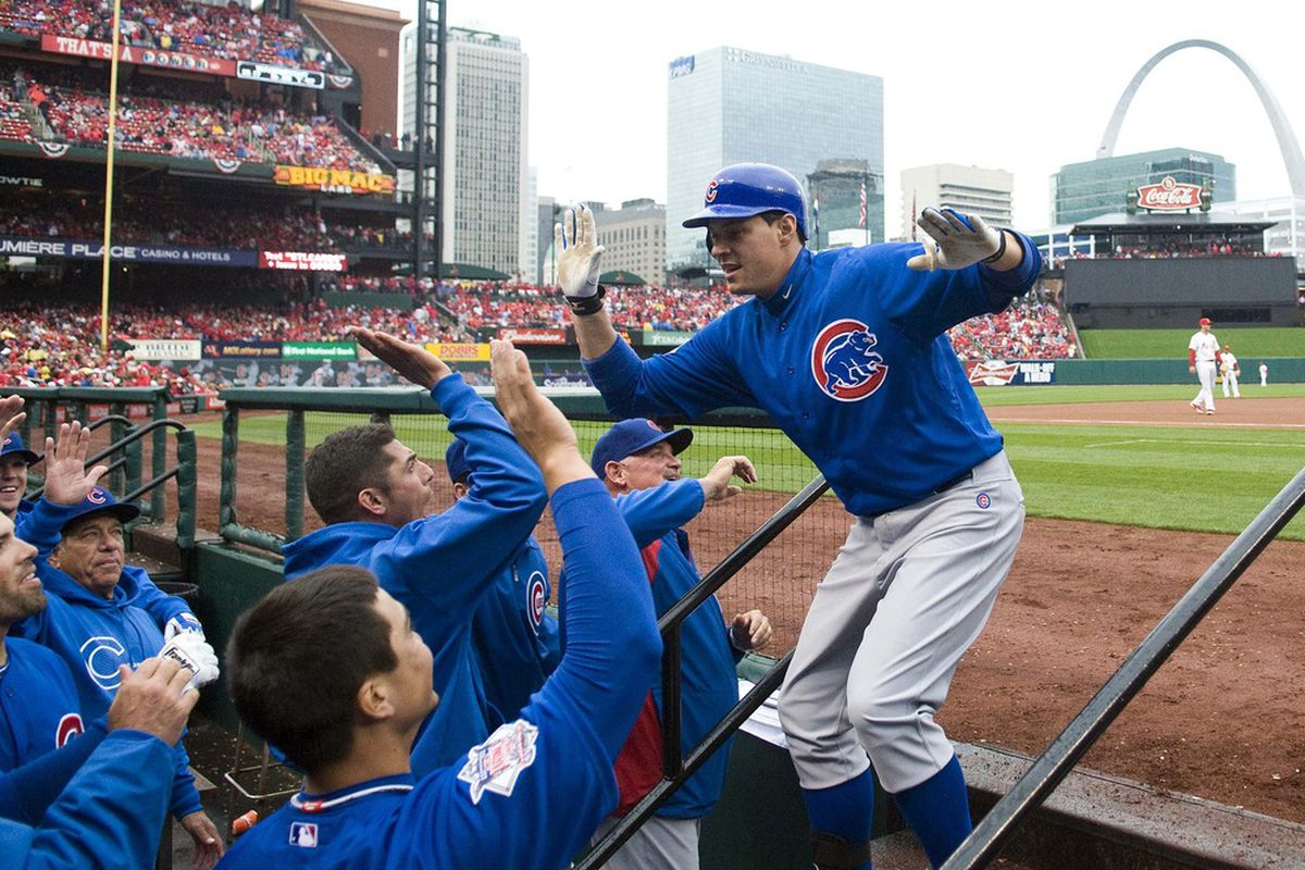 St. Louis, MO. USA; Chicago Cubs first baseman Bryan LaHair  is congratulated by teammates after hitting a grand slam off of St. Louis Cardinals starting pitcher Adam Wainwright  in the third inning at Busch Stadium. Credit: Jeff Curry-US PRESSWIRE