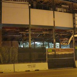 5:59 p.m. This view shows how deep the space is, that has been demolished over the front gate (Gate F) -