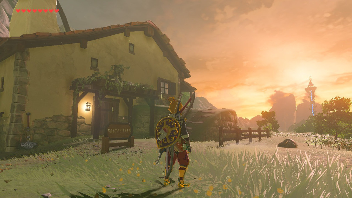 Link stands in front of a small village