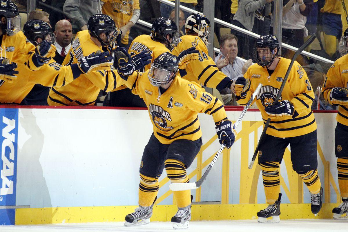 Kellen Jones celebrates with his teammates after scoring a goal against St. Cloud in last season's Frozen Four.